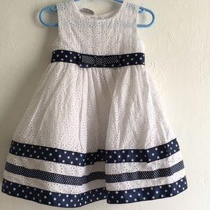White formal dress with polka dot details